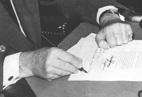Close-Up-President Roosevelt signing the Burke-Wadsworth Conscription Act